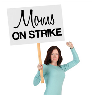 Mom holding picket sign