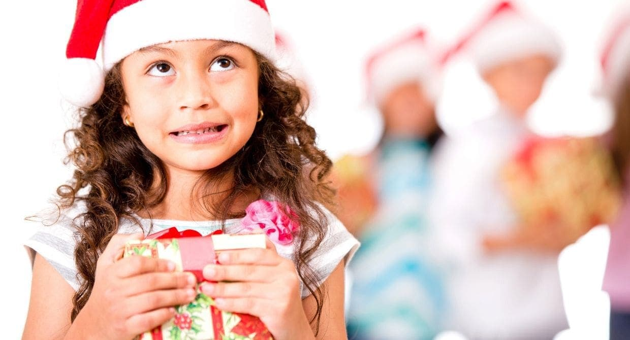 Girl in Santa hat holding a present