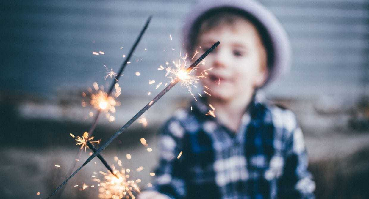 Little boy holding sparklers