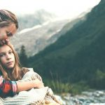 Mom and Teen Daughter Hugging in Mountains