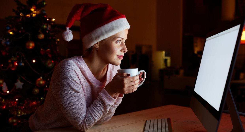lady in santa hat staring at computer screen