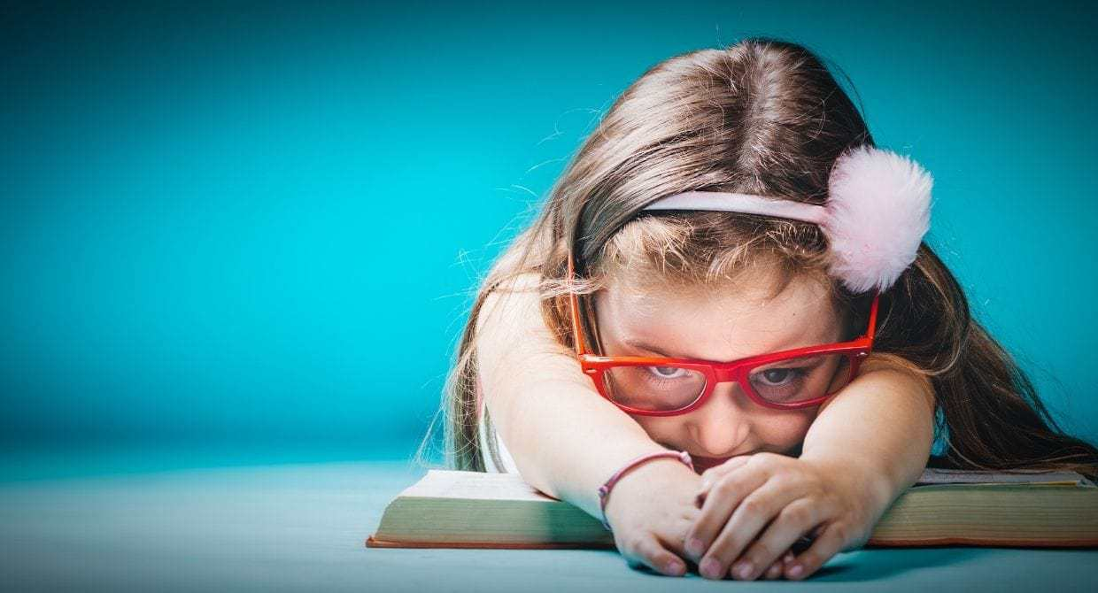 little girl with glasses bored