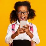 young african girl holding smartphone