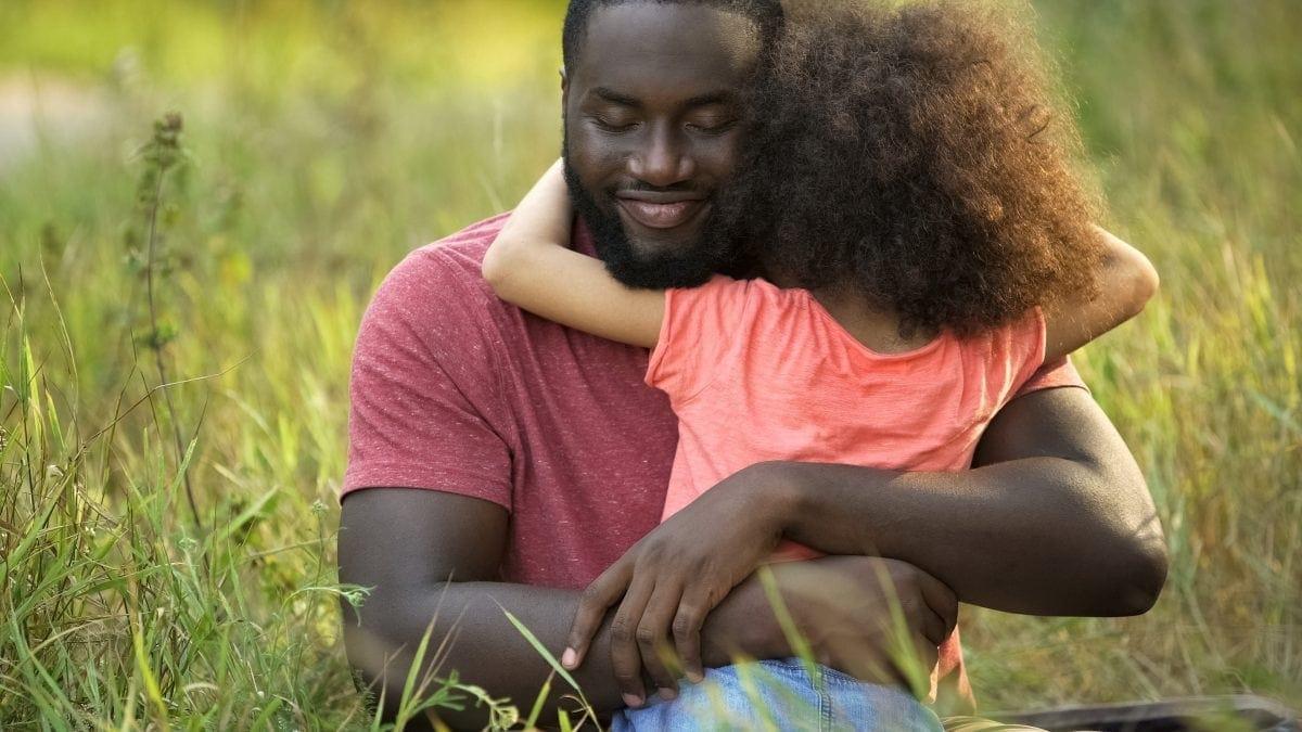 Daddy hugging little girl
