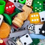 Dice and board game pieces in a big pile